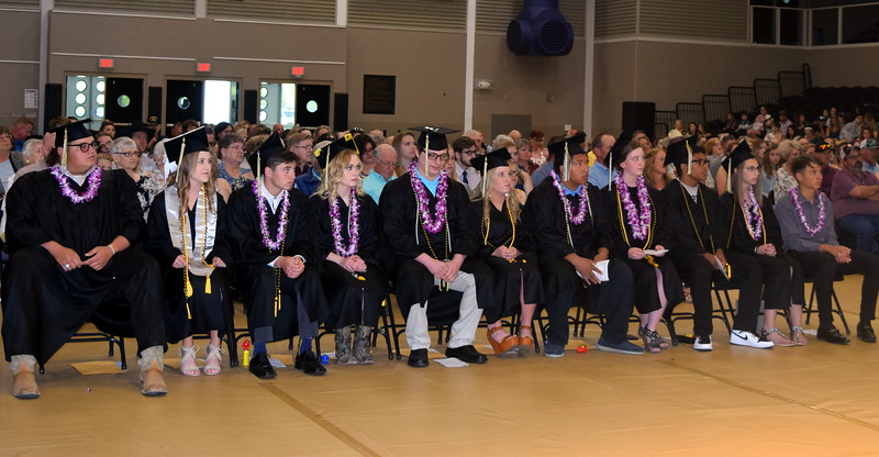 Caliche High School graduates listen to a speaker at the commencement ceremony Saturday, May 25, 2019.