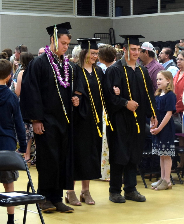 . Bryce Hill, Brooke Stromberger and Adam Zink make their way to their seats at Caliche High School\'s Commencement Ceremony Saturday, May 25, 2019