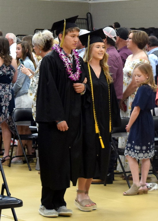 . Tyler Torres and Kaitlyn Houghton make their way to their seats at Caliche High School\'s Commencement Ceremony Saturday, May 25, 2019
