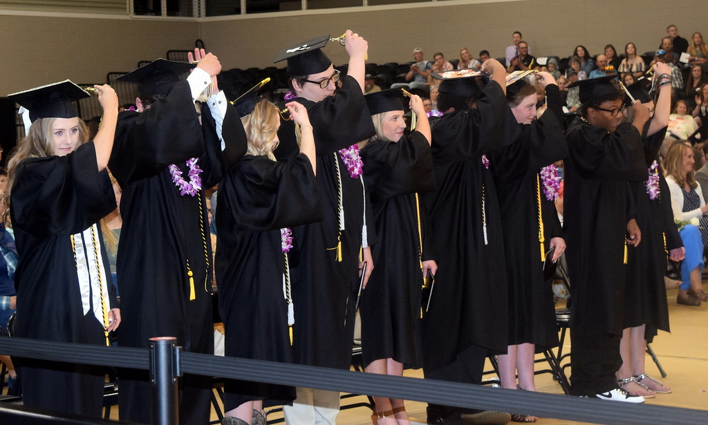. Caliche High School graduates filp their tassels after receiving their diplomas at the commencement ceremony Saturday, May 25, 2019.
