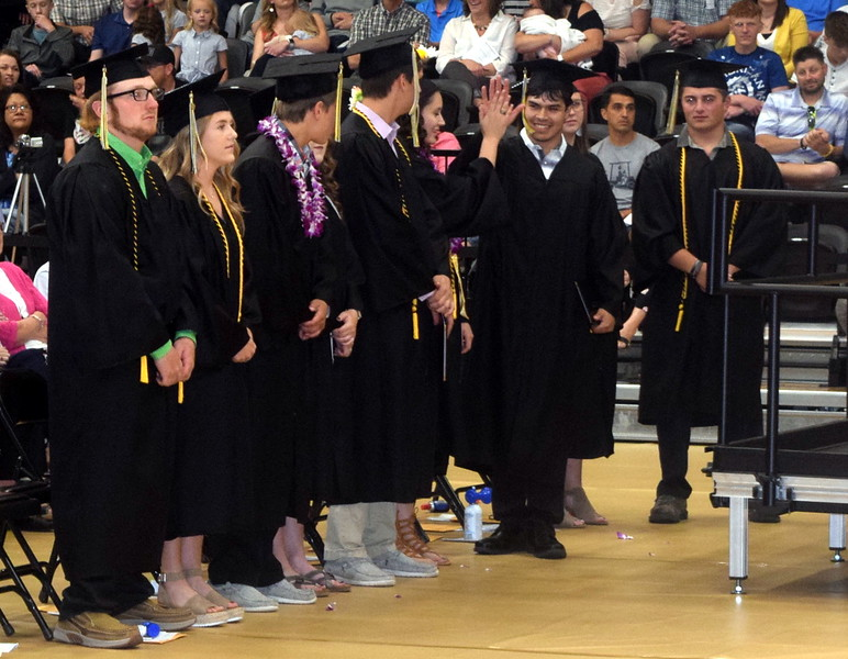 Talor Devie gets a high five after receiving his diploma at Caliche High School's Commencement Ceremony Saturday, May 25, 2019.