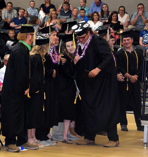 Clayton Funkhouser is congratulated by his fellow graduates after receiving his diploma at Caliche High School's Commencement Ceremony Saturday, May 25, 2019.