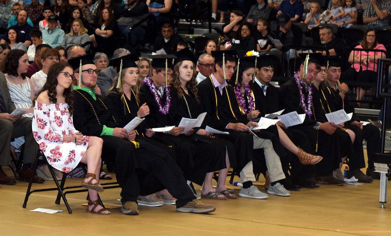 Caliche High School graduates listen to a speaker during the commencement ceremony Saturday, May 25, 2019.