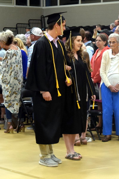 Ezekiel Johnson and MadaLynn Painter make their way to their seats at Caliche High School's Commencement Ceremony Saturday, May 25, 2019.