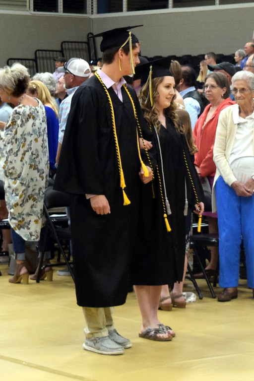. Ezekiel Johnson and MadaLynn Painter make their way to their seats at Caliche High School\'s Commencement Ceremony Saturday, May 25, 2019.