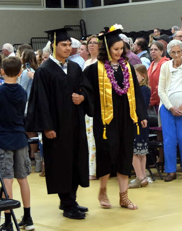 . Talor Devie and Alexia Hernandez make their way to their seats at Caliche High School\'s Commencement Ceremony Saturday, May 25, 2019