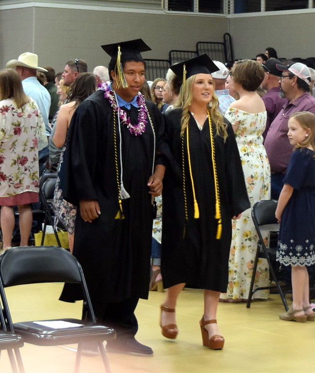 . Josh Kokes and Kinlie Lewis make their way to their seats at Caliche High School\'s Commencement Ceremony Saturday, May 25, 2019