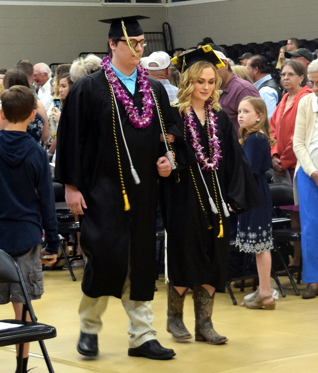 . Jeremiah Wooldridge and Jamie Kielian make their way to their seats at Caliche High School\'s Commencement Ceremony Saturday, May 25, 2019