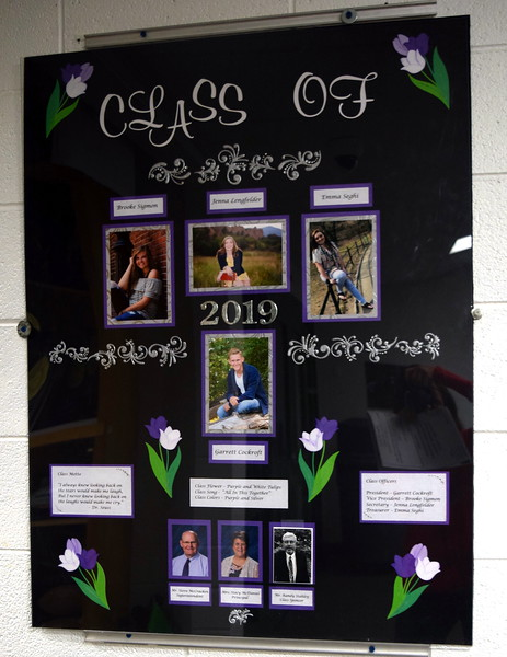 The Fleming High School 2019 class composite hangs in the hallway at the commencement ceremony Sunday, May 19, 2019.