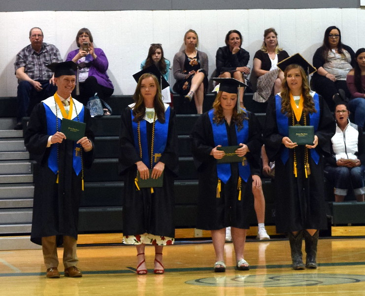 Fleming High School graduates, from left; Garrett Cockroft, Jenna Lengfelder, Emma Seghi and Brooke Sigmon, are presented after receiving their diplomas at the commencement ceremony Sunday, May 19, 2019.