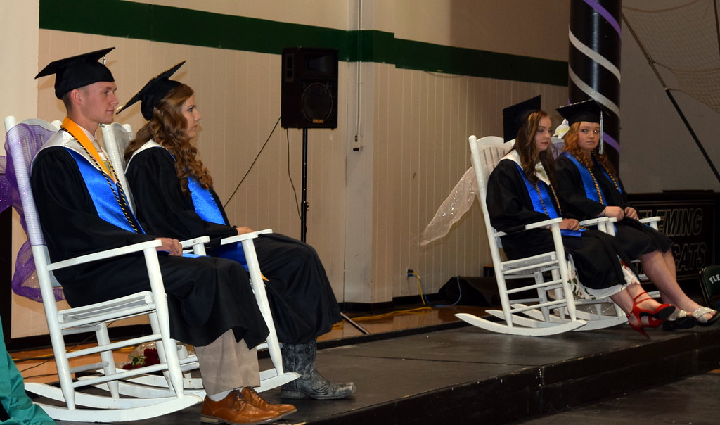 . The four graduates of Fleming High School listen to remarks at the commencement ceremony Sunday, May 19, 2019. From left; Garrett Cockroft, Brooke Sigmon, Jenna Lengfelder and Emma Seghi.