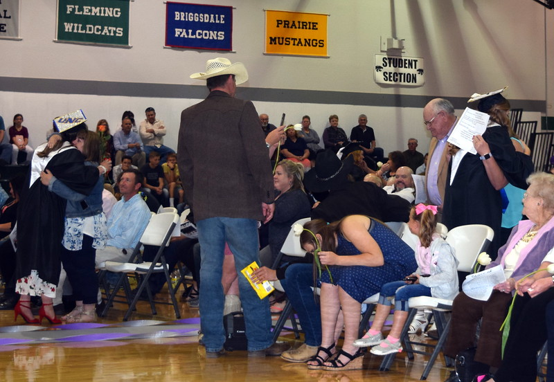 Graduates get hugs from family and friends during the parent and family recognition portion of Fleming High School's Commencement Ceremony Sunday, May 19, 2019.