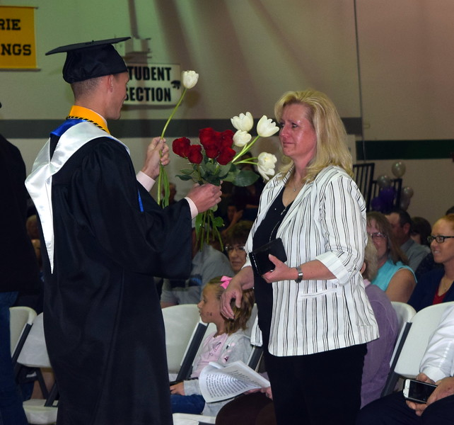 Graduates presented flowers to family and friends during the recognition of parents and family portion of Fleming High School's Commencement Ceremony Sunday, May 19, 2019.