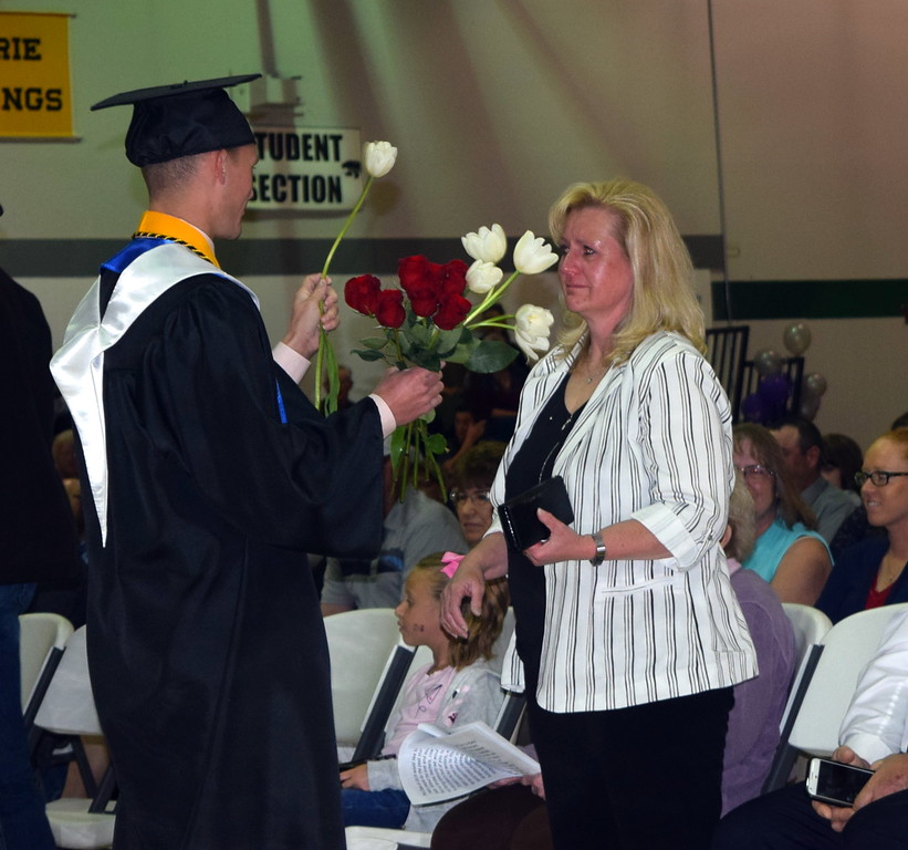 . Graduates presented flowers to family and friends during the recognition of parents and family portion of Fleming High School\'s Commencement Ceremony Sunday, May 19, 2019.