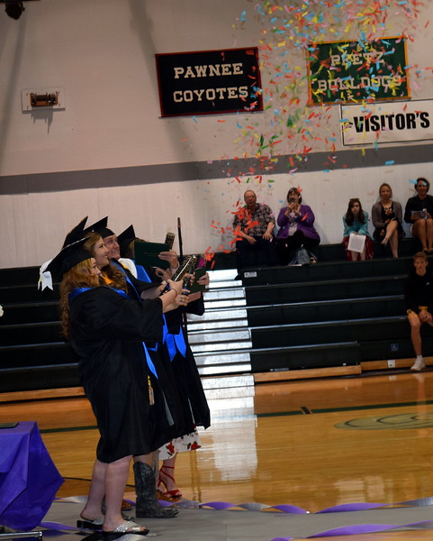 Fleming High School graduates celebrate at the completion of the commencement ceremony Sunday, May 19, 2019.