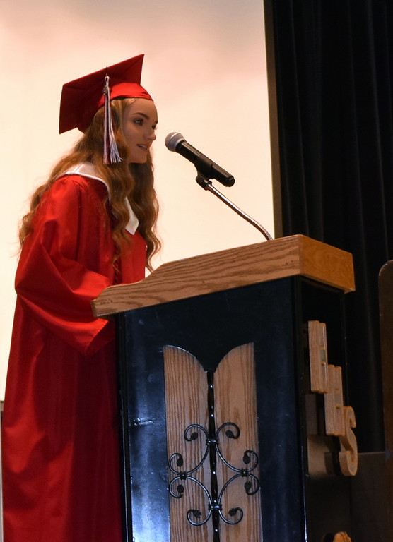 . Haxtun High School\'s second salutatorian, Claire Swan, gives remarks during the commencement ceremony Sunday, May 19, 2019.