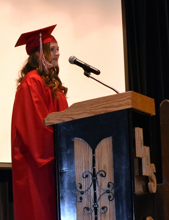 . Haxtun High School graduate Isabelle Helfer presents the class composite at the commencement ceremony Sunday, May 19, 2019.