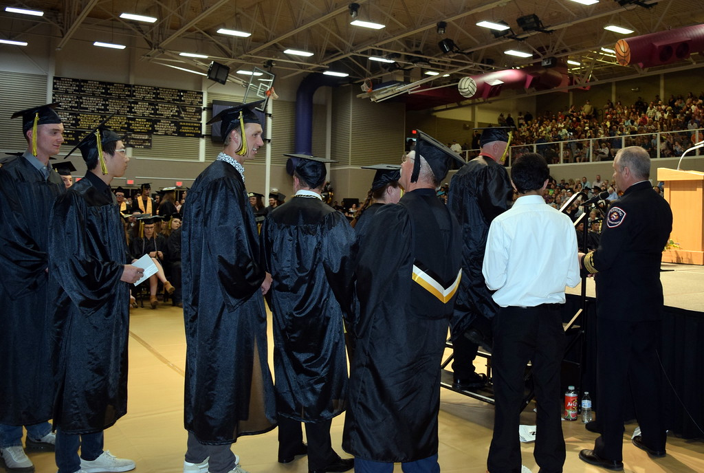 . Fire science students wait their turn to walk across the stage at Northeastern Junior College\'s Commencement Ceremony Friday, May 17, 2019.