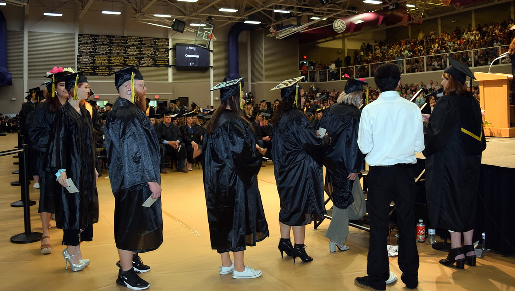 . Cosmetology graduates wait for their turn to walk across the stage at Northeastern Junior College\'s Commencement Ceremony Friday, May 17, 2019.
