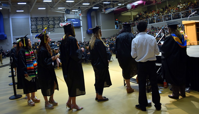 Northeastern Junior College graduates wait their turn to walk across the stage at the commencement ceremony Friday, May 17, 2019.