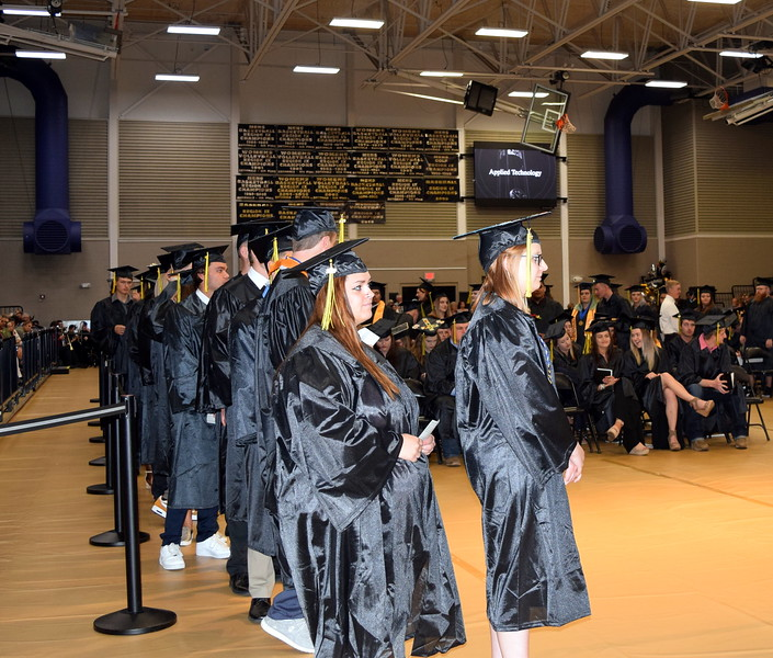Graduates wait in line for their turn to walk across the stage at Northeastern Junior College's Commencement Ceremony Friday, May 17, 2019.