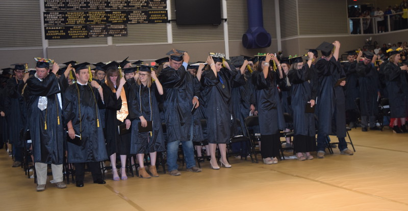 Northeastern Junior College graduates flip their tassels at the conclusion of the commencement ceremony Friday, May 17, 2019.