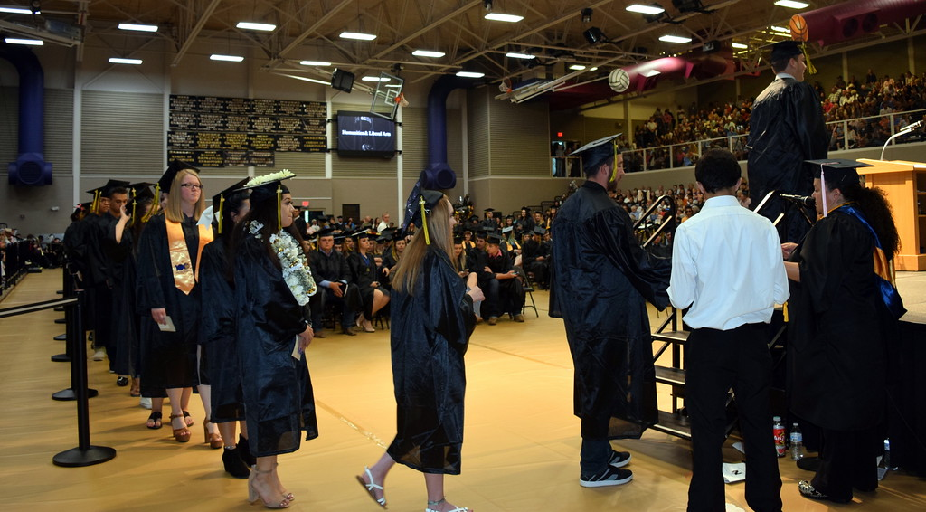 . Liberal arts students make their way on stage to receive their degrees and/or certificates at Northeastern Junior College\'s Commencement Ceremony Friday, May 17, 2019.