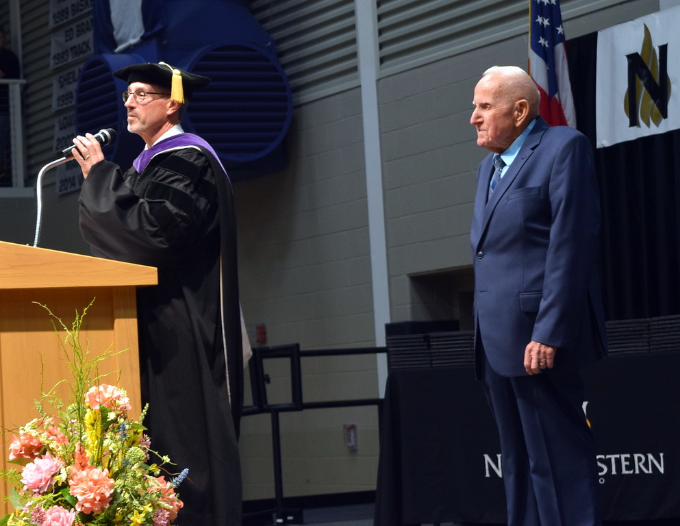 . Northeastern Junior College President Jay Lee leads the audience in wishing Jack Annan, director of the Alumni Association and Mr. NJC, a happy 86th birthday at the college\'s commencement ceremony Friday, May 17, 2019.