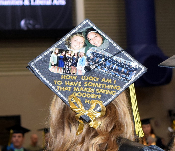 A Northeastern Junior College graduate pays tribute to her friends and teamates on her cap at the commencement ceremony Friday, May 17, 2019.