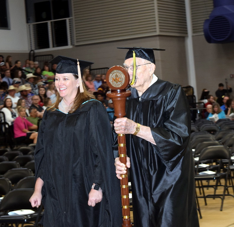 . Alumni Mace Bearer Robert W. Montgomery, of the class of 1948, and Faculty/Staff Marshal Amanda Kerker led the graduates into the Bank of Colorado Event Center at Northeastern Junior College\'s Commencement Ceremony Friday, May 17, 2019.