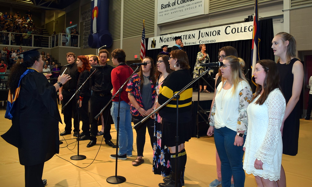 """. The NJC Contemporary Choir performs the \""""National Anthem,\"""" under the direction of Celeste Delgado-Pelton, at Northeastern Junior College\'s Commencement Ceremony Friday, May 17, 2019."""