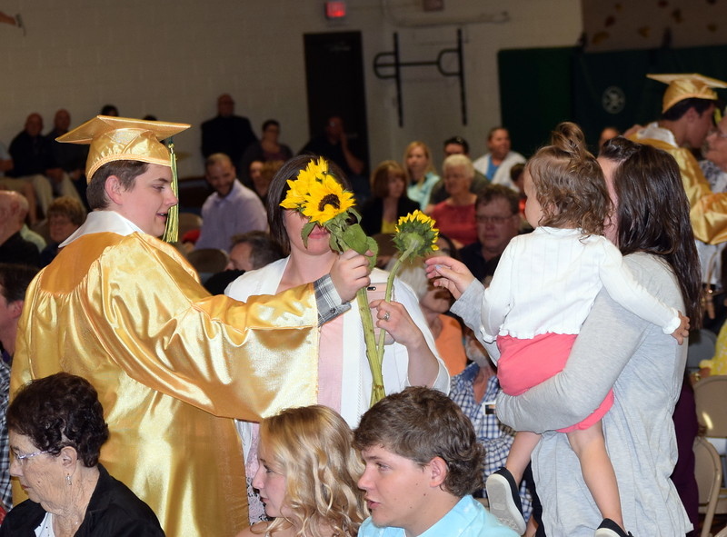 Blake Roelle hands out flowers to family and friends at Peetz School's Commencement Ceremony Sunday, May 12, 2019.