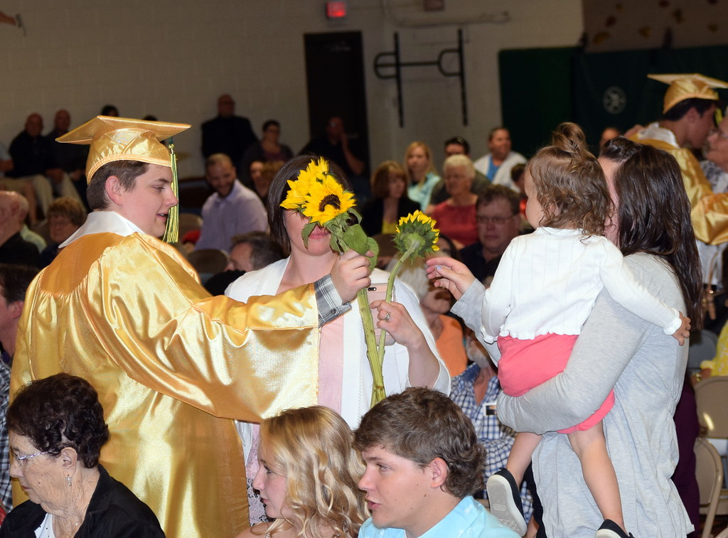 . Blake Roelle hands out flowers to family and friends at Peetz School\'s Commencement Ceremony Sunday, May 12, 2019.
