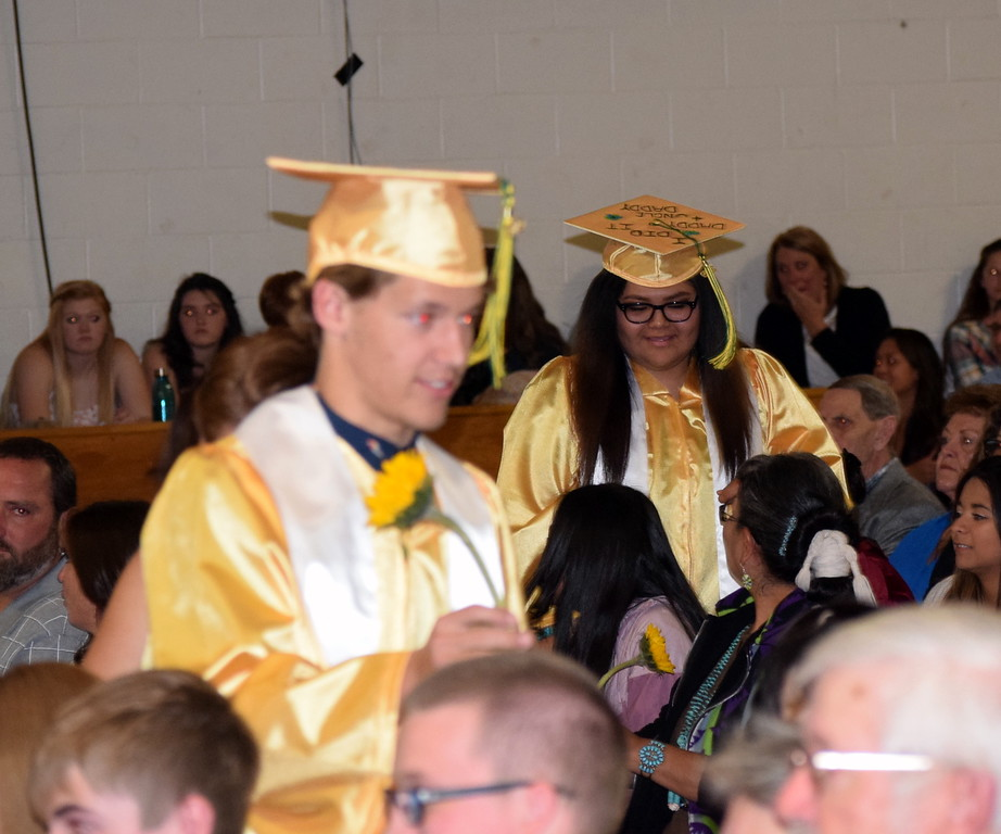 . Graduates hand out flowers to family and friends at Peetz School\'s Commencement Ceremony Sunday, May 12, 2019.