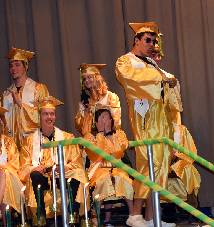 . Bryson Long breaks out his sunglasses and a special shirt after receiving his diploma at Peetz School\'s Commencement Ceremony Sunday, May 12, 2019.