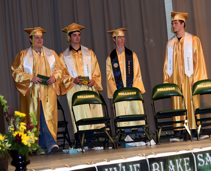 New graduates exit the stage after receiving their diplomas at Peetz School's Commencement Ceremony Sunday, May 12, 2019.