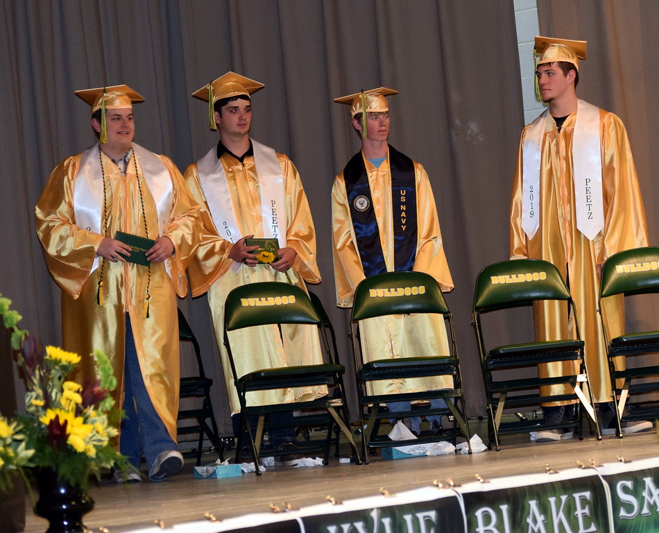 . New graduates exit the stage after receiving their diplomas at Peetz School\'s Commencement Ceremony Sunday, May 12, 2019.
