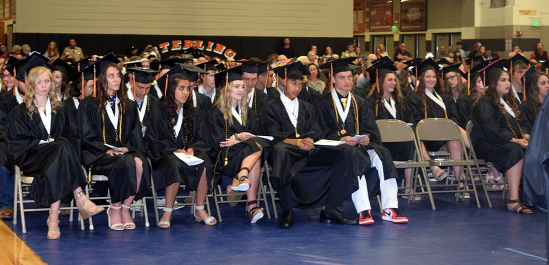 Sterling High School graduates listen to the choir sing at the commencement ceremony Saturday, May 25, 2019.