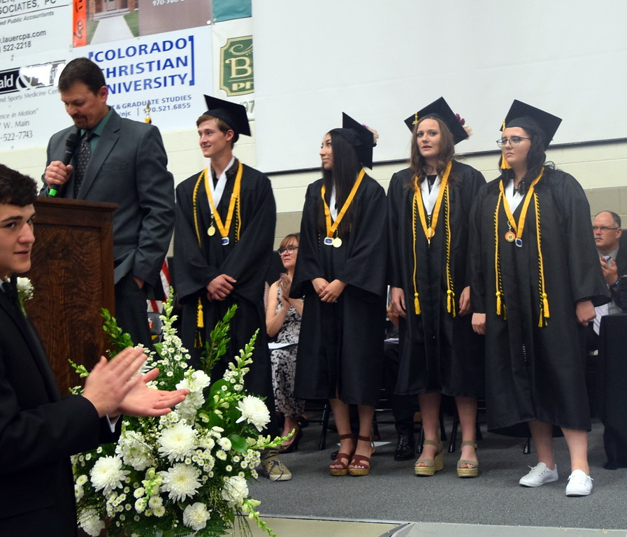 . Mark Appelhans, Sterling High School assistant principal, recognizes the four students who maintained a 4.0 or above grade point average while in high school during the commencement ceremony Saturday, May 25, 2019. From left; Greyson Dudley, Jasmine Renteria, Kathleen Masters and Brooke Bohler.