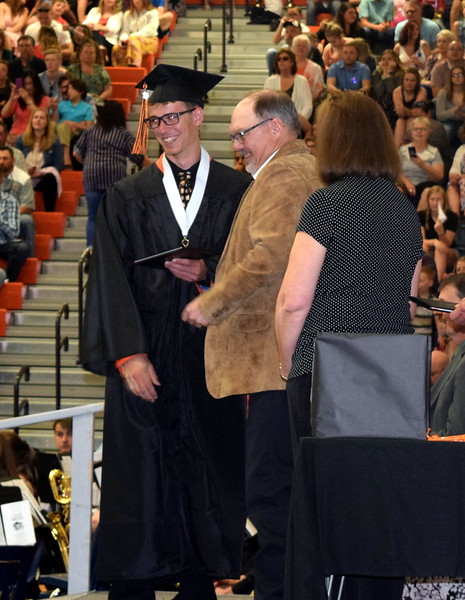 Bryce Gilliland, who was severely injured in a car accident last June, smiles as he receives his diploma at Sterling High School's Commencement Ceremony Saturday, May 25, 2019.
