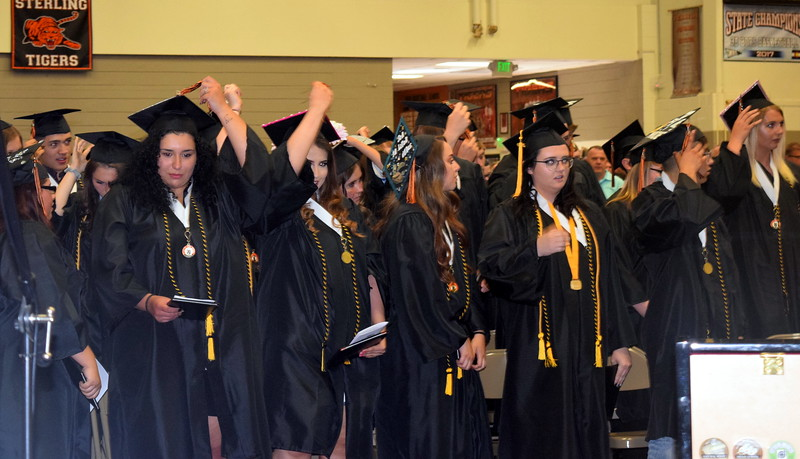 Sterling High School graduates flip their tassels at the conclusion of the commencement ceremony Saturday, May 25, 2019.
