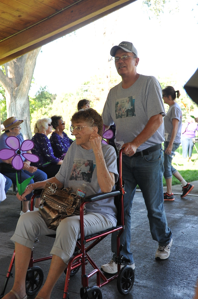 Participants gather in the Columbine Park pavilion after their lap around the park for the Walk to End Alzheimer's Saturday, Aug. 24, 2013.