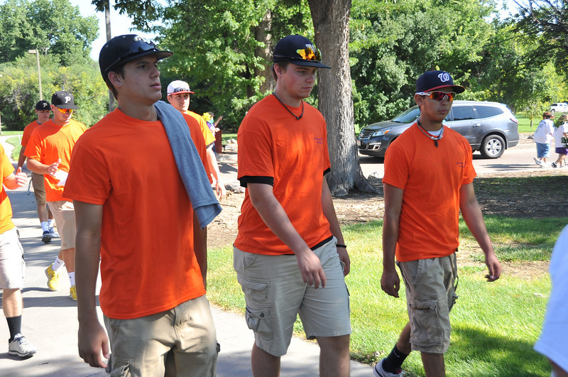 Members of the NJC baseball team make their way around Columbine Park during the Walk to End Alzheimer's Saturday, Aug. 24, 2013.