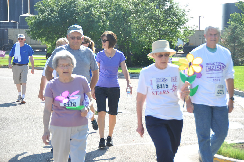 Participants make their way towards the finish line at the Walk to End Alzheimer's Saturday, Aug. 24, 2013, at Columbine Park.