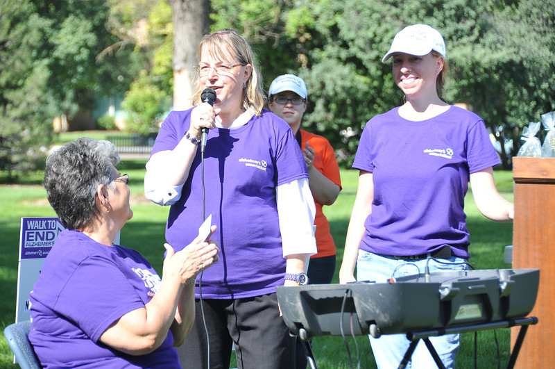 Marcia Shafer, regional director for the Alzheimer's Association, talks at the Walk to End Alzheimer's Saturday, Aug. 24, 2013, at Columbine Park.