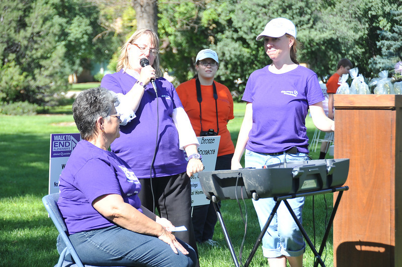 Marcia Shafer of the Alzheimer's Association talks at the Walk to End Alzheimer's Saturday, Aug. 24, 2013, at Columbine Park.