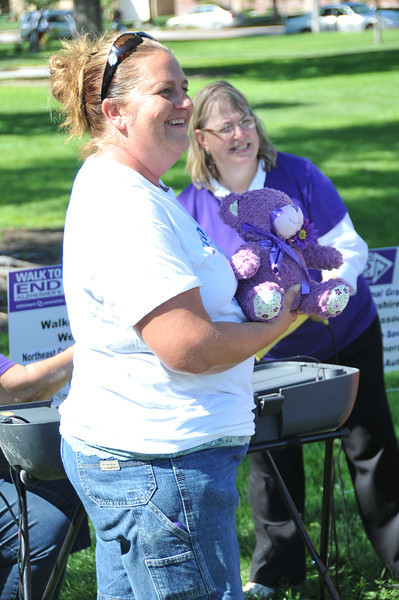 Jolene Gary won the 2013 Memory Bear, raffled in memory of Marilyn Reib, who made bears for a raffle for the Alzheimer's Association for several years, atParticipants show off their line dancing moves at the Walk to End Alzheimer's Saturday, Aug. 24, 2013, at Columbine Park.
