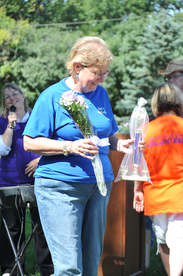 Connie Clark accepts the top team fundraiser award for Bob's Walkers at the Walk to End Alzheimer's Saturday, Aug. 24, 2013, at Columbine Park.