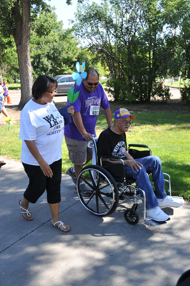 Participants take a lap around Columbine Park Saturday, Aug. 24, 2013, for the Walk to End Alzheimer's.