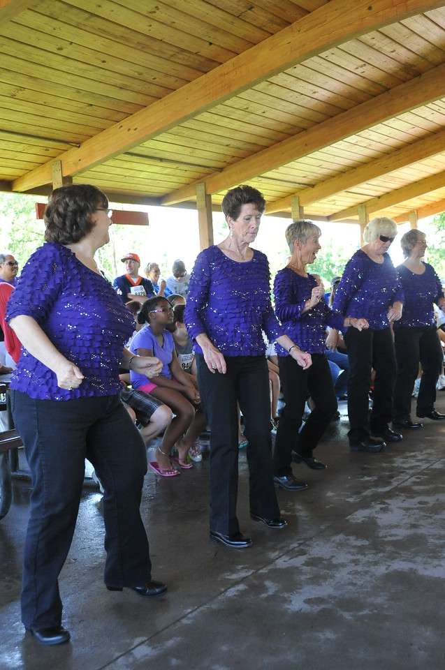 Boots in Motion performs at  the Walk to End Alzheimer's Saturday, Aug. 24, 2013, at Columbine Park.